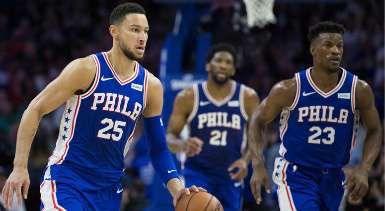 a49e70878e02 Philadelphia 76ers guard Ben Simmons (25) dribbles up court in front of  guard Jimmy