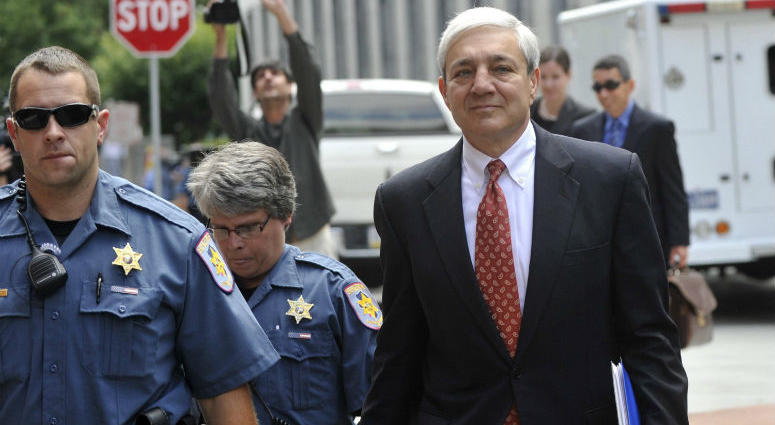 Former Penn State president Graham Spanier, accused of covering up Jerry Sandusky abuse allegations, leaves his preliminary hearing in Harrisburg in July 2013.