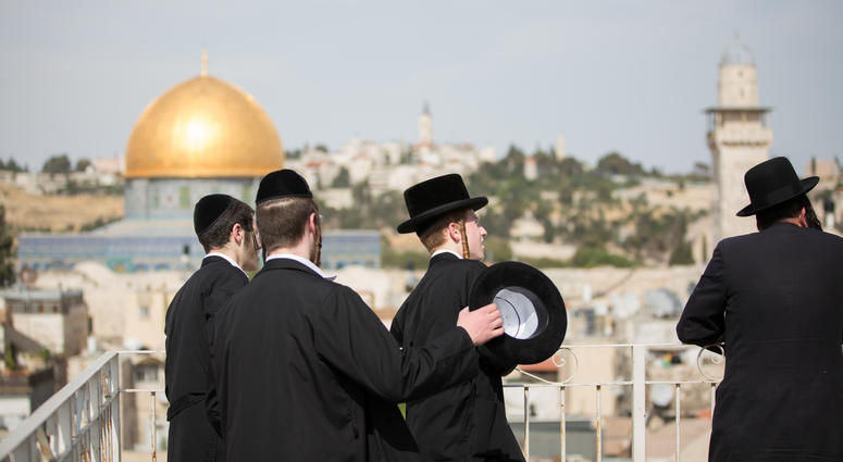 Ultra-Orthodox Jews look towards the direction of the Western Wall during U.S. President Donald Trump's visit to the Western Wall in Jerusalem.