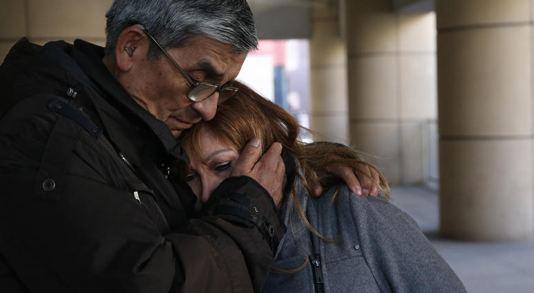 Esperanza Perez, mother of Miguel Perez, is comforted by Luis Retamal after receiving news that her son was denied U.S. citizenship on Thursday, March 15, 2018.