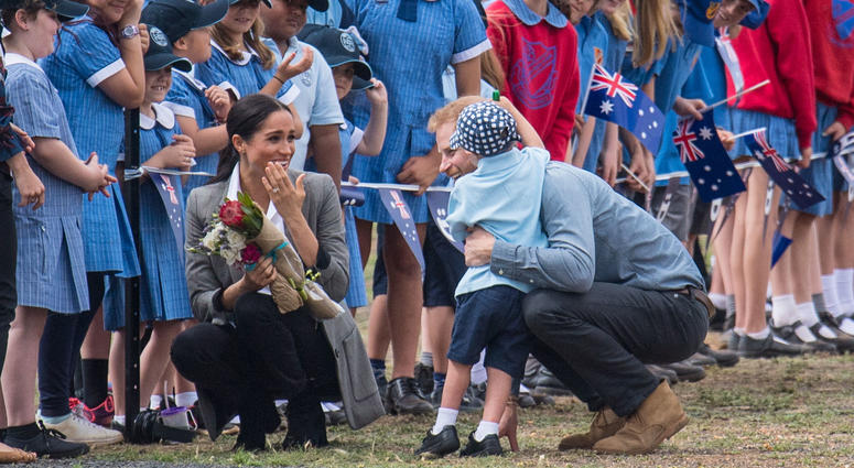 10/17/2018 - The Duke and Duchess of Sussex are greeted by schoolchildren as they arrive at Dubbo City Regional Airport, in Dubbo, New South Wales, on the second day of the royal couple's visit to Australia.