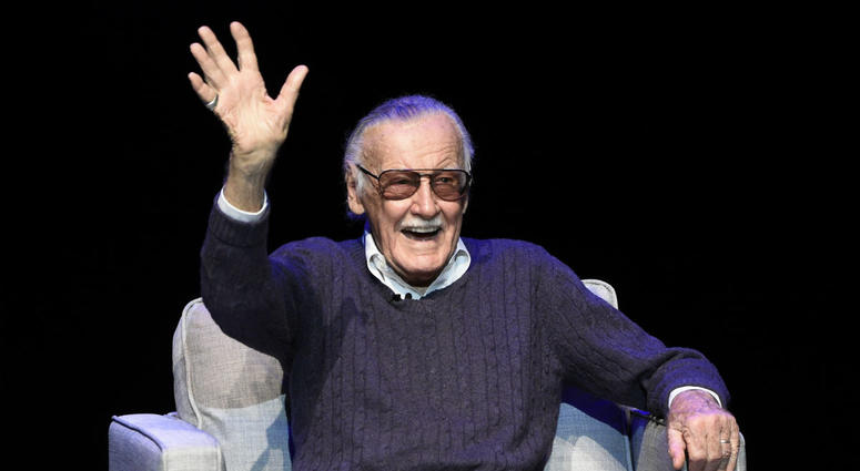 """In this Aug. 22, 2017 file photo, comic book writer Stan Lee waves to the audience after being introduced onstage at the """"Extraordinary: Stan Lee"""" tribute event at the Saban Theatre in Beverly Hills, Calif."""