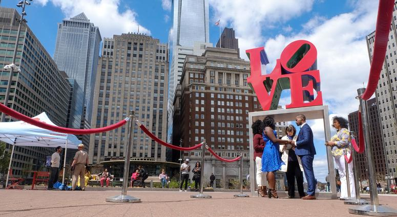 Claire Louis and Tyhim Hawkins get married at Love Park.
