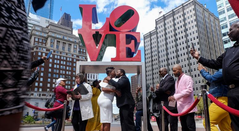 Claire Louis and Tyhim Hawkins get married at Love Park on April 10, 2019.