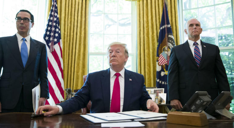 President Donald Trump listens to a reporter's question after signing an executive order to increase sanctions on Iran, in the Oval Office of the White House, Monday, June 24, 2019, in Washington.
