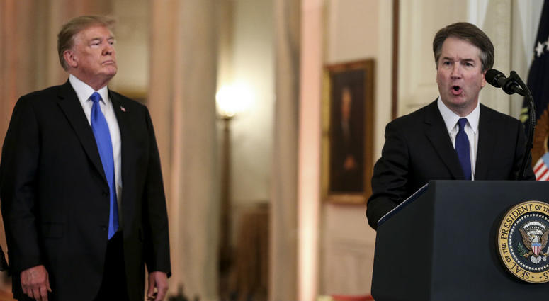 Supreme Court nominee judge Brett Kavanaugh speaks as President Donald Trump listens, in the East Room of the White House on July 9, 2018 in Washington, DC.