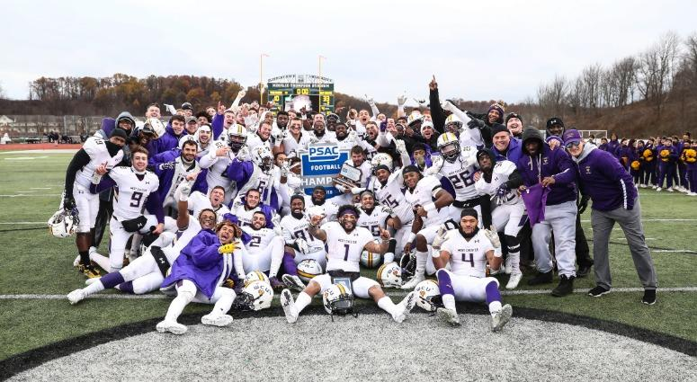 The West Chester University football team celebrates its PSAC title.