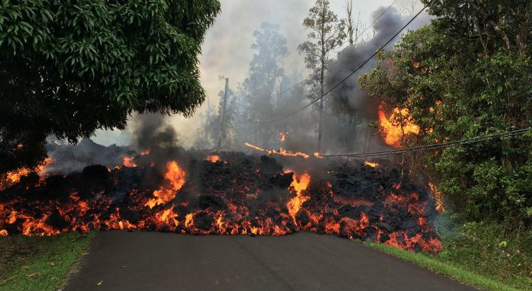 A lava flow moves on Makamae Street in Leilani Estates Sunday morning.