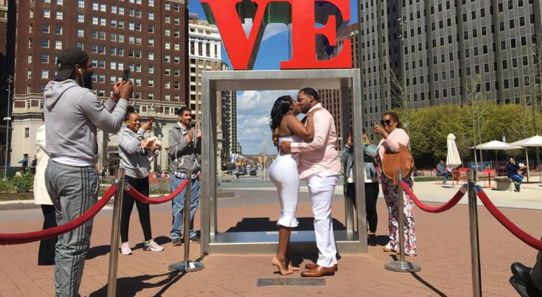 Ikea Faust and Kuzell Bivins get married in Love Park.