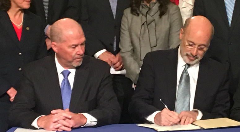 Gov. Wolf signs an executive order in the Capitol rotunda Tuesday.
