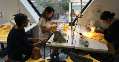 Moore College of Art and Design students sew school uniforms for kids in South Africa.