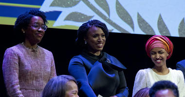From left, Lauren Underwood D-IL, Ayanna Pressley, D-Mass., and Ilhan Omar D-MN, during the swearing-in ceremony of Congressional Black Caucus members of the 116th Congress at The Warner Theatre in Washington, Thursday, Jan. 3, 2019.