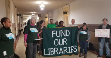 ​Alice Wells, second from left, paints a dire picture of neighborhood libraries, hobbled since the city cut budgets during the Great Recession.