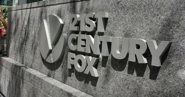 This Aug. 1, 2017, file photo shows the 21st Century Fox sign outside of the News Corporation headquarters building in New York.
