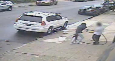 """Video surveillance captures Jovaun Patterson approaching Li """"Mike"""" Poeng with an AK-47 at 54th and Spruce streets, May 8, 2018."""