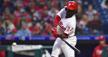 Philadelphia Phillies' Odubel Herrera hits a three-run home run off Atlanta Braves' Julio Teheran during the first inning of a baseball game.