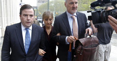 Actress Allison Mack, center, arrives with her legal team to Brooklyn Federal Court.