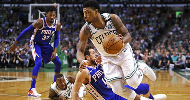 Boston Celtics guard Marcus Smart, right, drives past Philadelphia 76ers guard Marco Belinelli during the first quarter of Game 5.