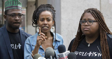 Donisha Prendergast, center, is joined by Kelly Fyffe Marshall, right, and Komi-Oluwa Olafimihan as she speaks during a news conference.