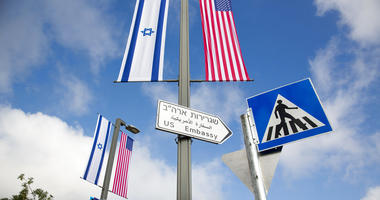 A road sign leading to the U.S. Embassy is seen ahead the official opening in Jerusalem.