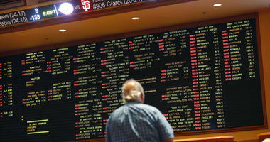 Betting odds are displayed on a board in the sports book at the South Point hotel and casino in Las Vegas.