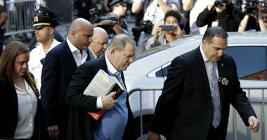 Harvey Weinstein arrives at the first precinct while turning himself to authorities following allegations of sexual misconduct, Friday, May 25, 2018, in New York.