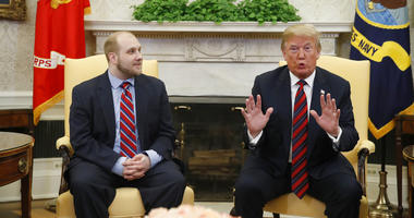 President Donald Trump, right, talks as Joshua Holt, who was recently released from a prison in Venezuela, joins him in the Oval Office of the White House.