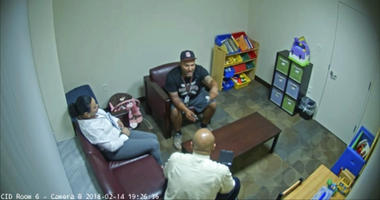 In this Feb. 14, 2018 frame from surveillance video provided by the Broward Sheriff's Office, Andrew Medina, center, is interviewed by detectives following the shooting at Marjory Stoneman Douglas High School in Florida.