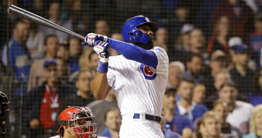 Chicago Cubs' Jason Heyward swings through his game-winning grand slam off Philadelphia Phillies relief pitcher Adam Morgan during the ninth inning.