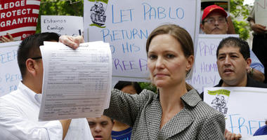 Legal Aid Society lawyer Jennifer WIlliams, who represents Ecuadorean restaurant worker Pablo Villavicencio, shows the Application for Stay of Deportation or Removal she filed at the offices of the Immigration and Customs Enforcement.