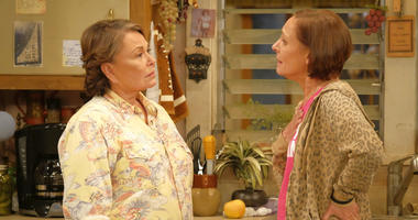 "In this image released by ABC, Roseanne Barr, left, and Laurie Metcalf appear in a scene from the reboot of the popular comedy series ""Roseanne."""