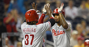 Philadelphia Phillies' Nick Williams, right, celebrates his two-run home run with Odubel Herrera (37) during the fifth inning of a baseball game against the Washington Nationals.