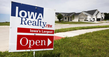 An open house sign is seen on a street corner in Waukee, Iowa.