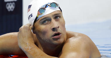 In this Aug. 9, 2016 file photo, United States' swimmer Ryan Lochte checks his time in a men's 4x200-meter freestyle heat at the 2016 Summer Olympics in Rio de Janeiro, Brazil.