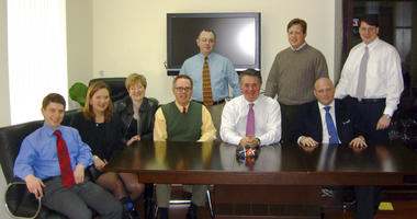 Konstantin Kilimnik is seen seated on the far left in a March 2006 photo as part of a collection of internal corporate records from the international political consulting offices of Donald Trump's ex-campaign chairman, Paul Manafort.