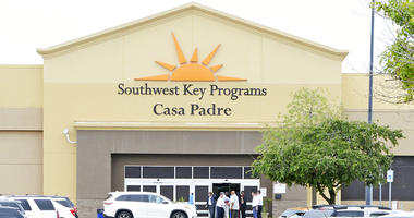 In this June 18, 2018 file photo, dignitaries take a tour of Southwest Key Programs Casa Padre, a U.S. immigration facility in Brownsville, Texas, where children who have been separated from their families are detained.