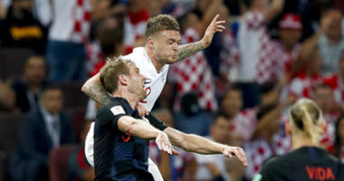 England's Kieran Trippier, right, challenges for the ball with Croatia's Ivan Strinic during the semifinal match between Croatia and England at the 2018 soccer World Cup in the Luzhniki Stadium.