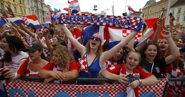 Supporter of Croatia national soccer team members wait to welcome the team on their arrival in Zagreb, Croatia.