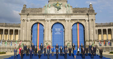 In this July 11, 2018, photo, President Donald Trump on stage during a group photo of NATO heads of state and government at Park Cinquantenaire in Brussels, Belgium.