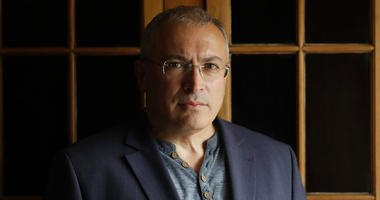 Russian opposition figure Mikhail Khodorkovsky, the former owner of the Yukos Oil Company, poses for a photograph after being interviewed by The Associated Press in London, Tuesday, July 24, 2018.