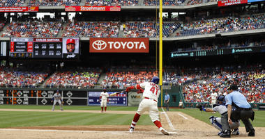 Philadelphia Phillies' Carlos Santana hits a three-run triple off Los Angeles Dodgers relief pitcher Scott Alexander during the fifth inning of a baseball game, Wednesday, July 25, 2018, in Philadelphia.