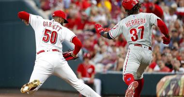 Cincinnati Reds relief pitcher Amir Garrett (50) puts out Philadelphia Phillies' Odubel Herrera at first in the fifth inning of a baseball game, Friday, July 27, 2018, in Cincinnati.
