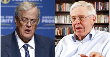 This combination of 2013 and 2012 file photos shows brothers David, left, and Charles Koch.