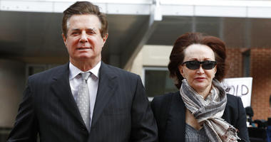 In this March 8, 2018, file photo, Paul Manafort, left, President Donald Trump's former campaign chairman, walks with this wife Kathleen Manafort, as they arrive at the Alexandria Federal Courthouse in Alexandria, Va.