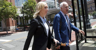 Paul Manafort's former bookkeeper Heather Washkuhn, left, walks to the Alexandria Federal Courthouse Thursday, Aug. 2, 2018, to testify at the trial of President Donald Trump's former campaign chairman's tax evasion and bank fraud trial.