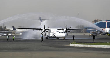 In this photo provided by Tasnim News Agency, a traditional water cannon salute welcomes an Iran Air's new commercial aircraft at Mehrabad airport in Tehran, Iran, Sunday, Aug. 5, 2018.