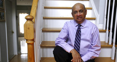 Kiran Shelat, a 65-year-old retired civil engineer, poses for a portrait in his home in Yardley, Pa. Shebat spent two years on a kidney transplant waiting list before signing up for a bold experiment in which patients received organs with hepatitis C.