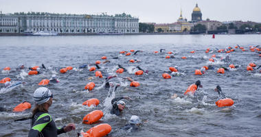 People swim after the mass start in the Neva River in St.Petersburg, Russia, Sunday, Aug. 12, 2018.