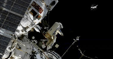In this image made from video provided by NASA, cosmonaut Sergey Prokopyev flings a Sirius nano-satellite into orbit from the International Space Station on Wednesday, Aug. 15, 2018.