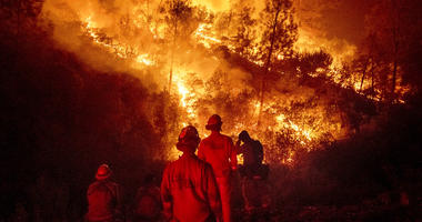 In this Aug. 7, 2018 file photo, firefighters monitor a backfire while battling the Ranch Fire, part of the Mendocino Complex Fire near Ladoga, Calif.